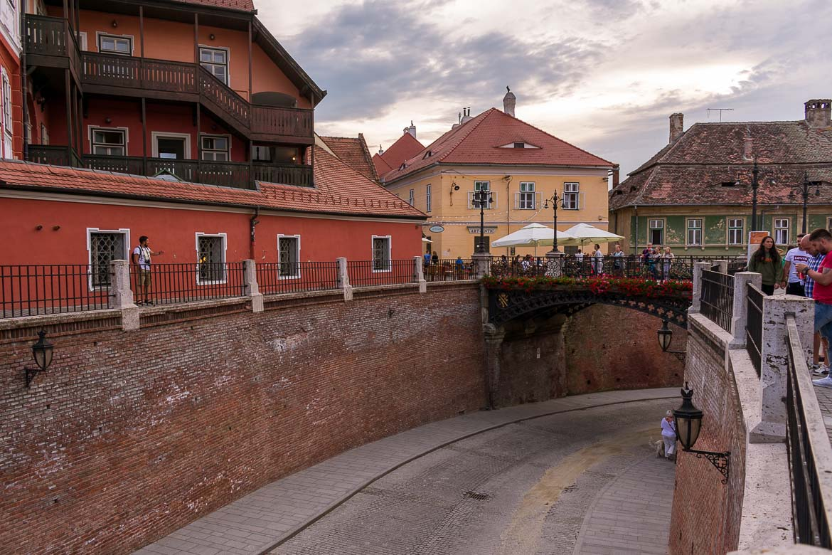 Watchful eyes on rooftops staring down at the Bridge of Lies in Sibiu Romania. 11 amazing things to do in Sibiu Romania.