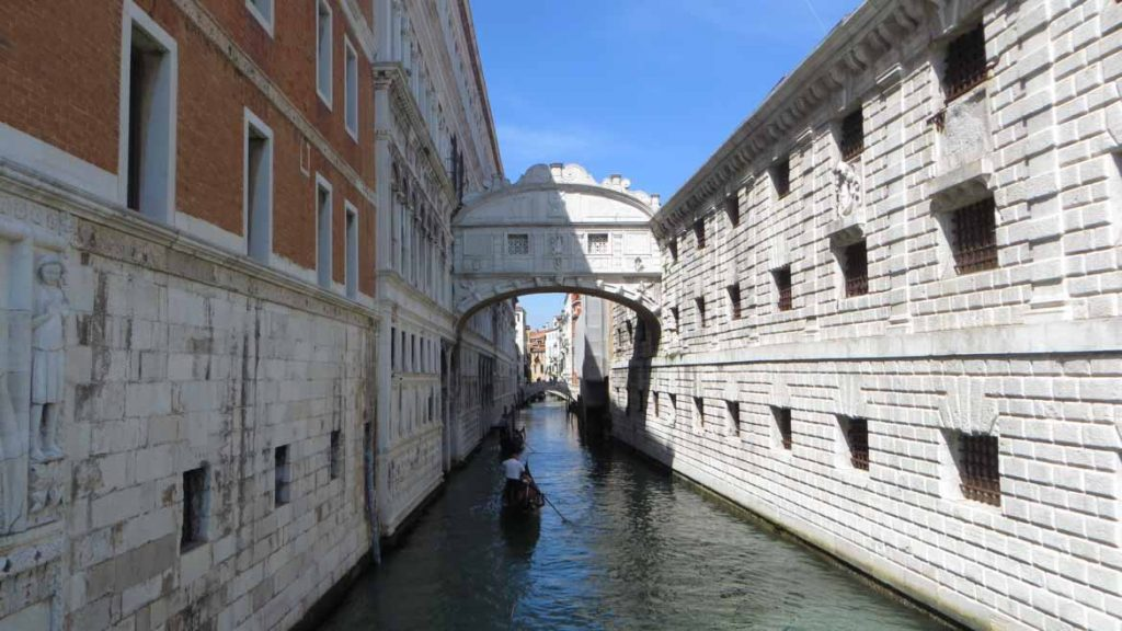 This photo shows the Bridge of Sighs in Venice, Italy. What to do in Venice: our complete guide to La Serenissima.
