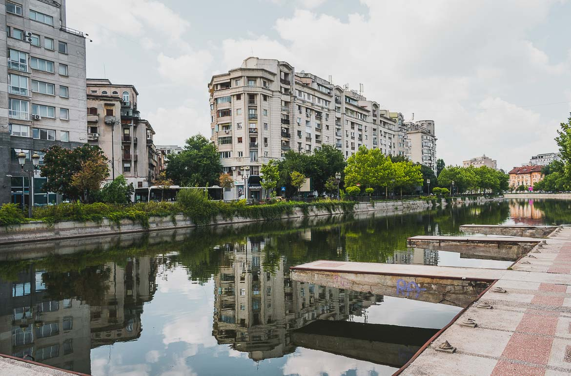 This is a photo of the Dambovita river that flows through Bucharest, Romania. Top things to do in Bucharest.