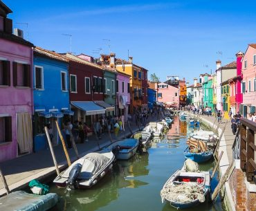 This photo shows the colourful houses in Burano, Veneto, Italy. Venice islands the perfect Venice day trip.