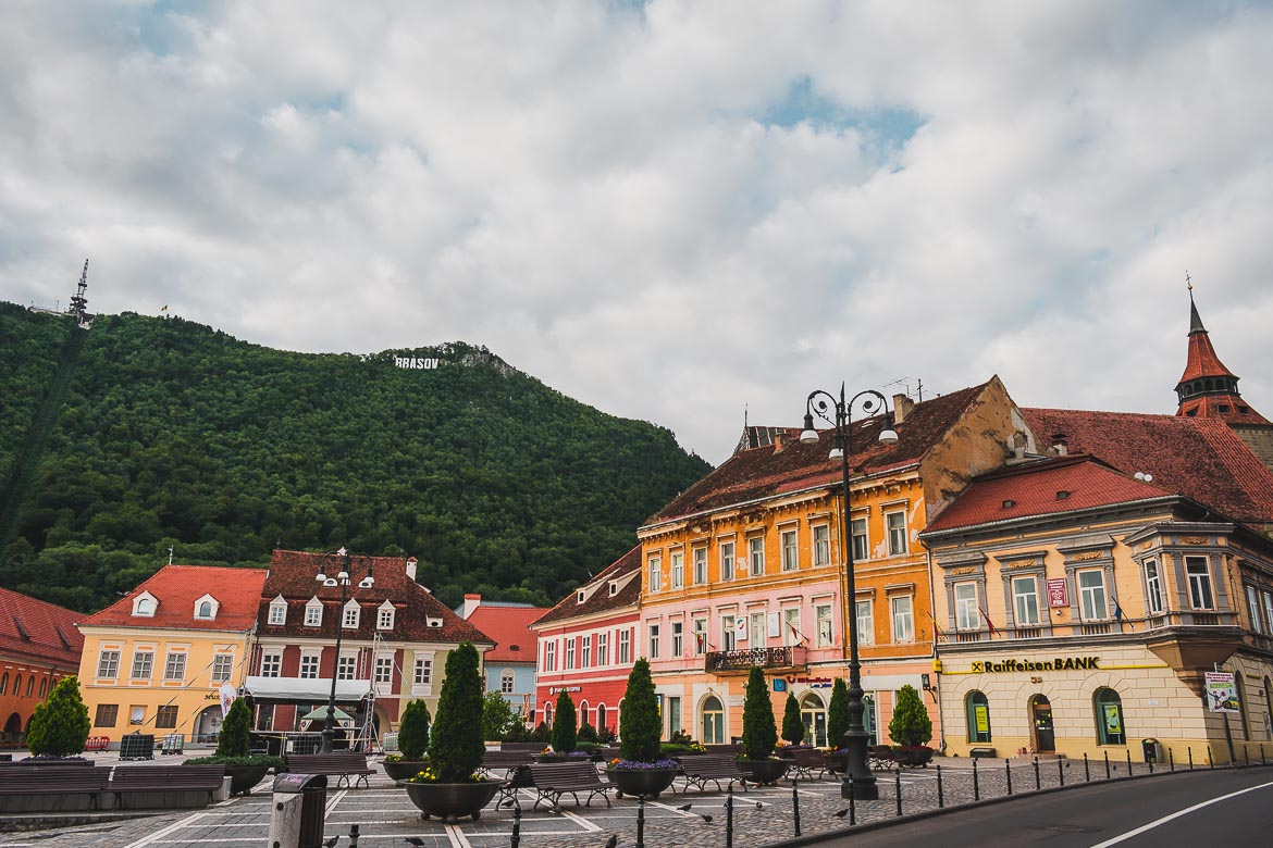 What to do in Brasov Romania in 2 days. Mount Tampa with its cable car and Hollywood-style sign overlooking Piata Sfatului below.