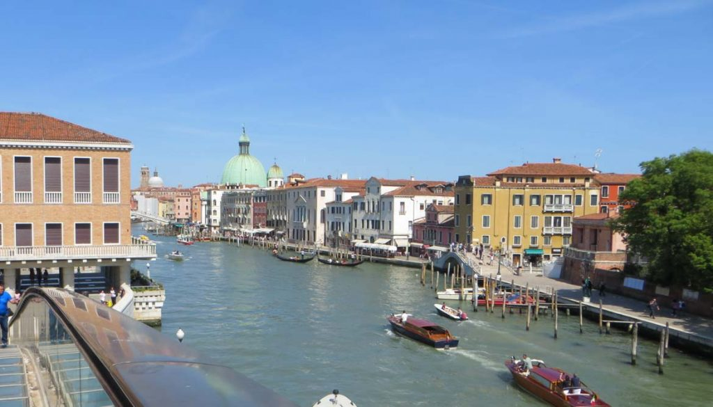 This photo shows the view of Venice and the Grand Canal from the Calatrava bridge. What to do in Venice: our complete guide to La Serenissima. Venice Italy.