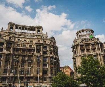 This photo shows two buildings typical of the Ceausescu era architecture. Bucharest walking tour of Communism, Romania.