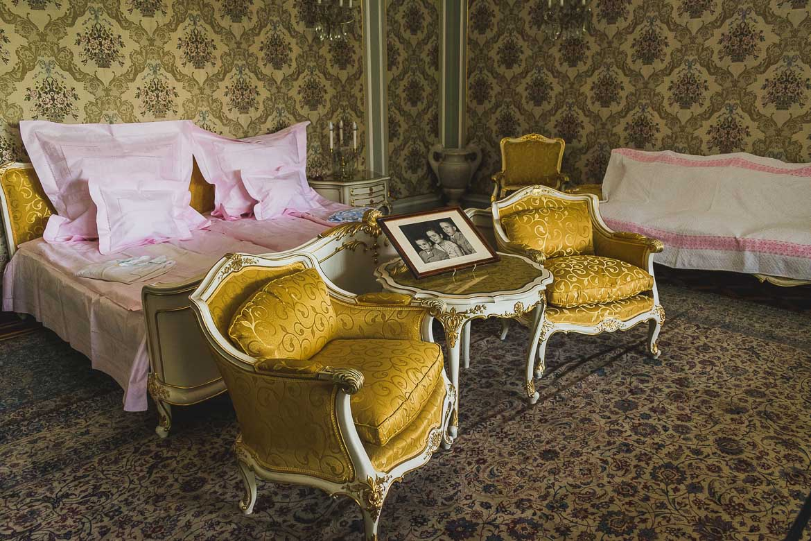 This photo shows the bedroom of Elena and Nicolae Ceausescu, one of the most impressive rooms in Ceausescu residence, Bucharest, Romania. The bed is made as if the couple are about to go to sleep.