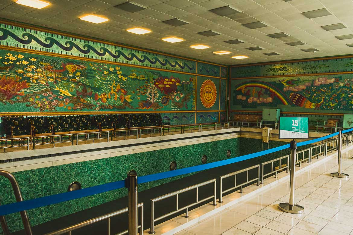 This photo shows the interior swimming pool at Ceausescu residence in Bucharest, Romania. The surrounding walls are decorated with incredible mosaics.