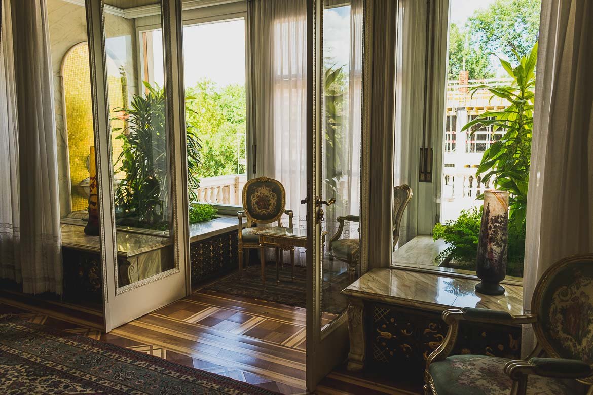 This photo shows large French doors opening to a sunny terrace in Ceausescu residence, Bucharest, Romania.