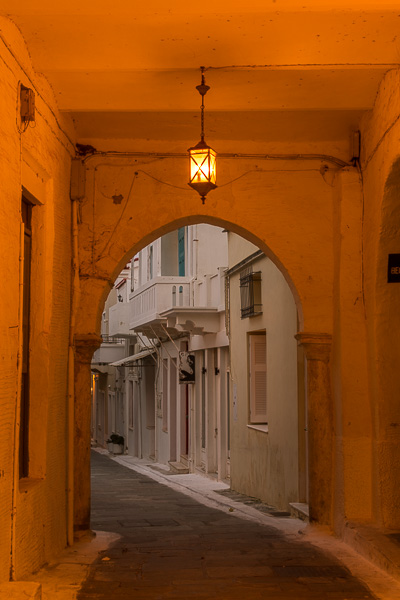 The arched passageway to the Old Town of Andros Island. Wandering around Chora is one of the top things to do in Andros Greece.