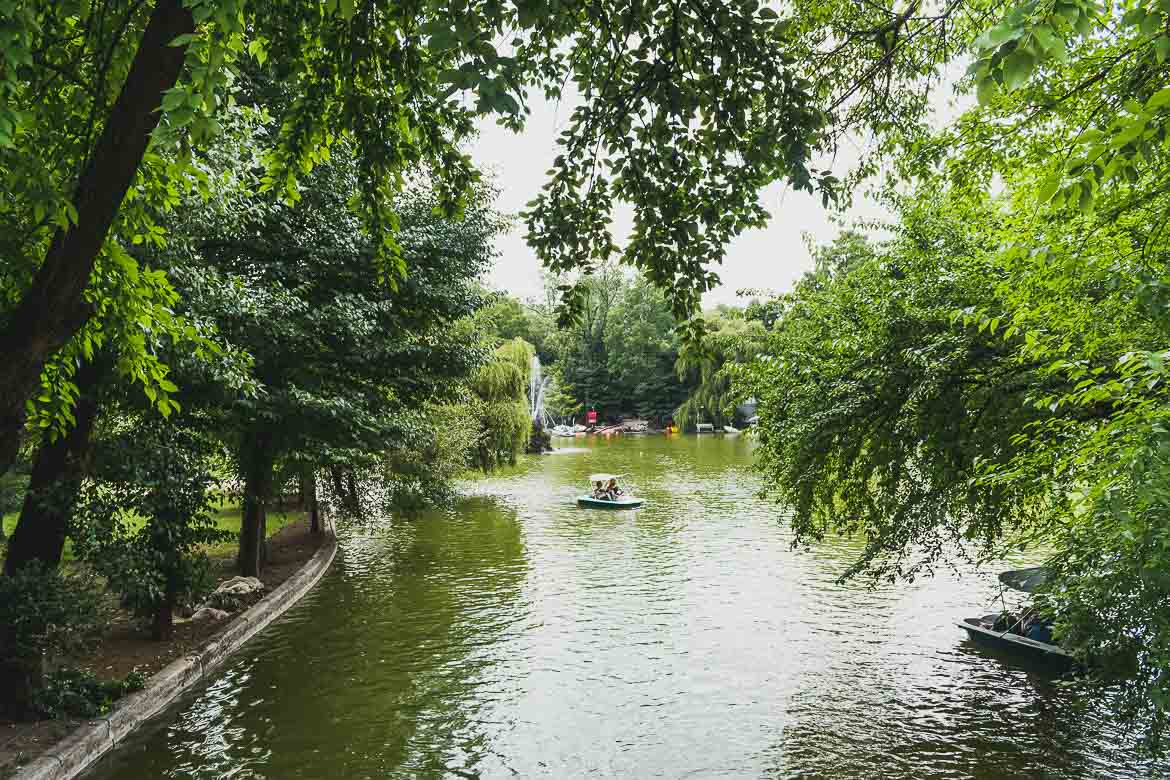 This is a photo of the lake in Cismigiu garden, the oldest park in Bucharest. Renting a rowboat or just walking around its quiet alleys is among the top things to do in Bucharest, Romania.