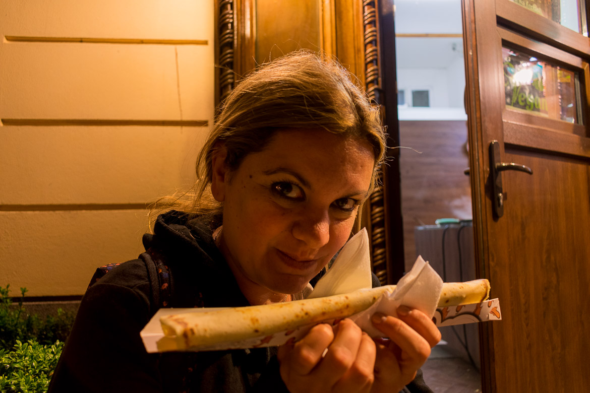 What to do in Brasov Romania in 2 days. Maria enjoying a chocolate crepe in Brasov!