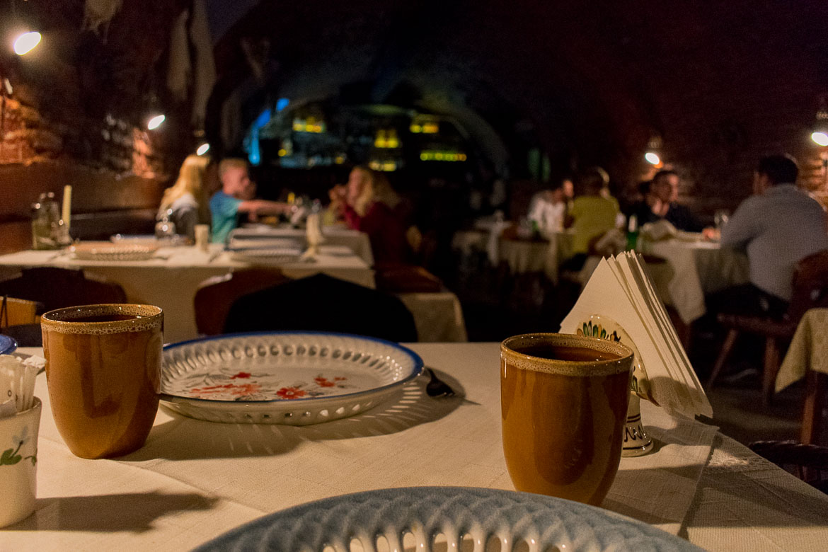 Crama Sibiul Vechi restaurant serves traditional Romanian cuisine in the atmospheric cellar of a 15th century building in the heart of Sibiu Romania. 11 amazing things to do in Sibiu Romania.