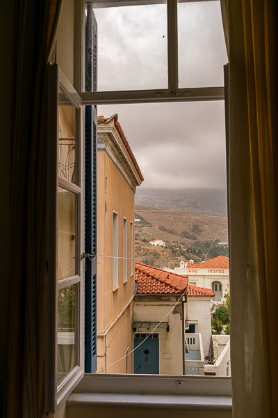 View of the neoclassical mansions of Chora Andros from the open window of our room at Egli Hotel.
