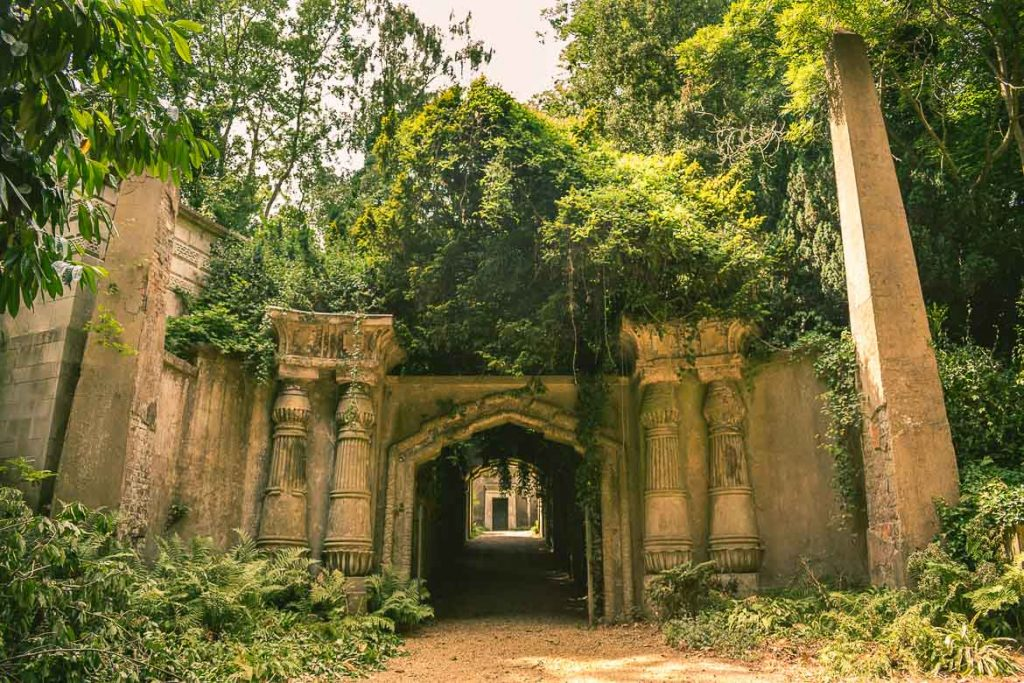 This photo shows the Egyptian Avenue in Highgate Cemetery West in London, England. A visit to Highgate Cemetery is a must for all Victorian London enthusiasts.