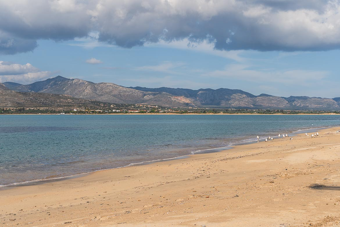 Panoramic shot of Kontogoni, the most underrated beach in Elafonisos Greece. The coast of Lakonia is visible in the background.