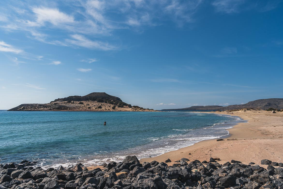This is a panoramic shot of Mikros Simos Beach with its turquoise waters and golden sand.