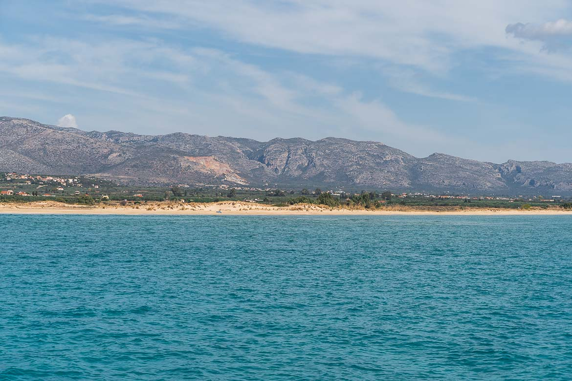 This is a panoramic shot of Pavlopetri Beach as seen from the ferry to Elafonisos Greece.