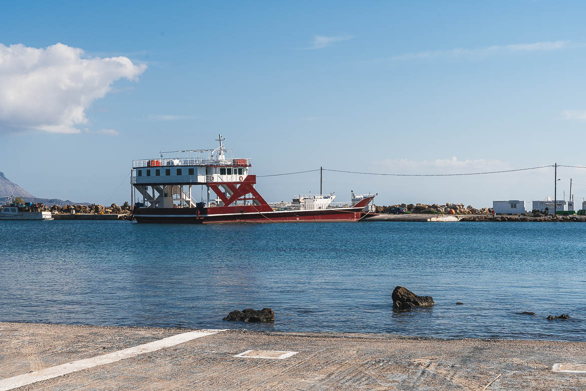 This image shows a red ferry anchored at Elafonisos port.