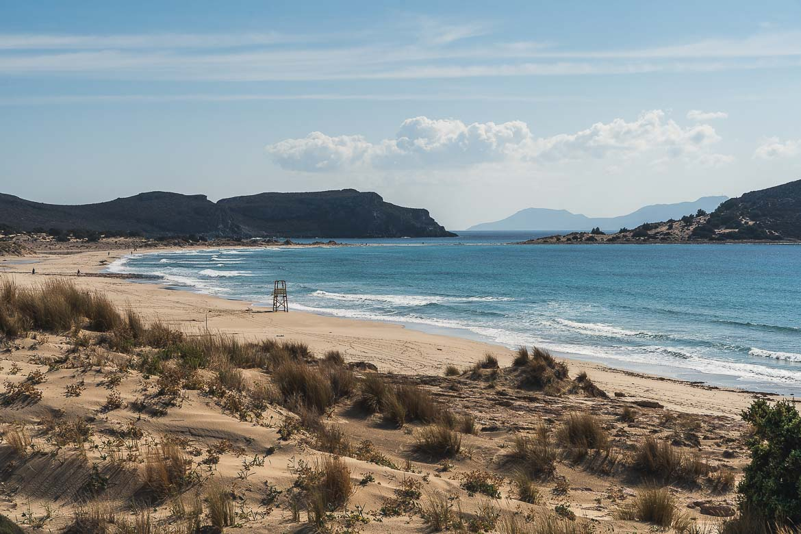This is a panoramic shot of Megalos Simos Beach with its dunes on a windy day.