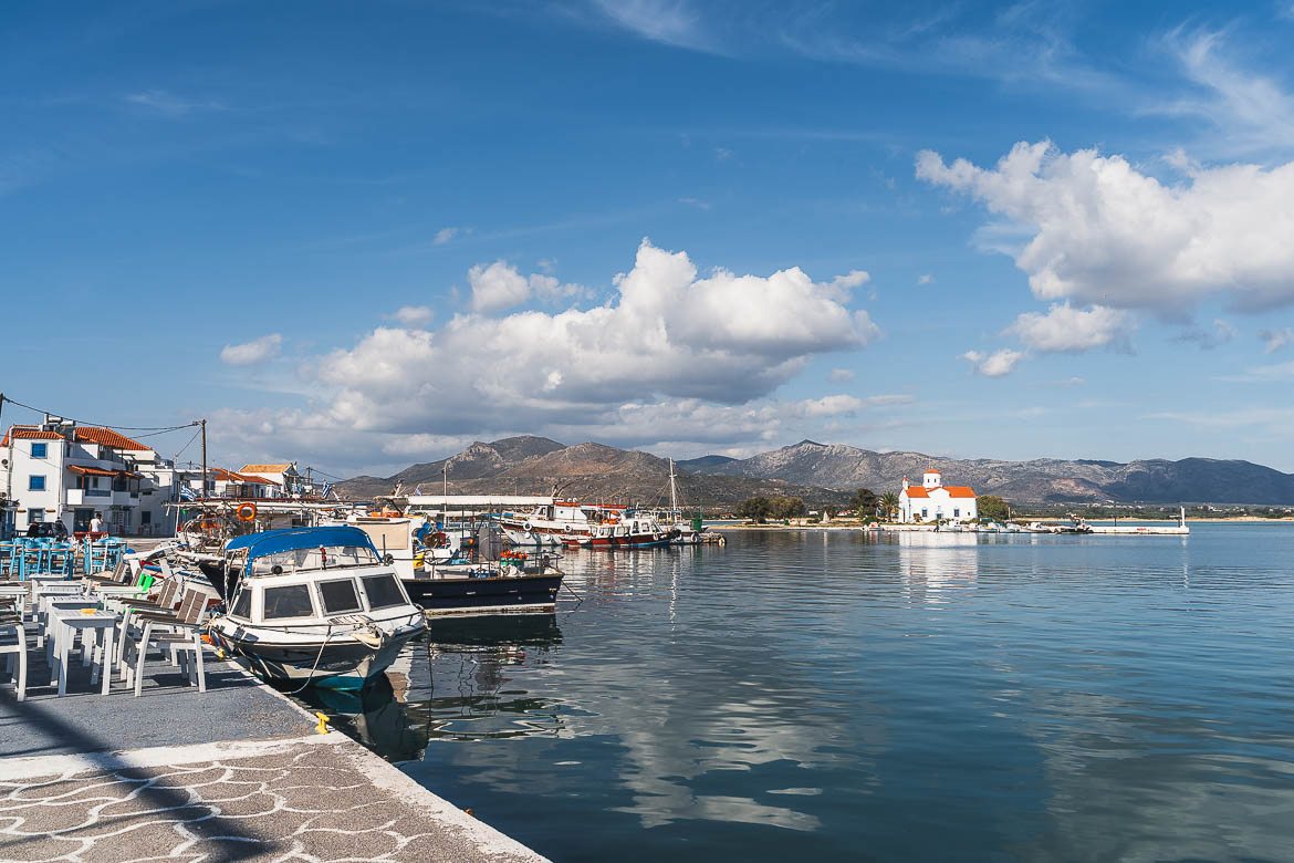 This is a panoramic shot of Elafonisos Town on a sunny day with the church of Agios Spiridonas in the background.