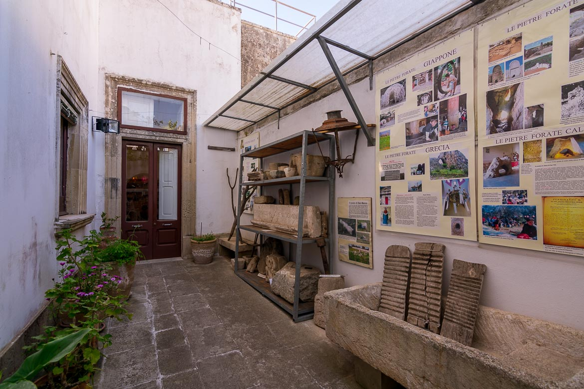 This photo shows the courtyard of the building that houses the museum in Calimera. There are some informative boards as well as some ancient relics on display.