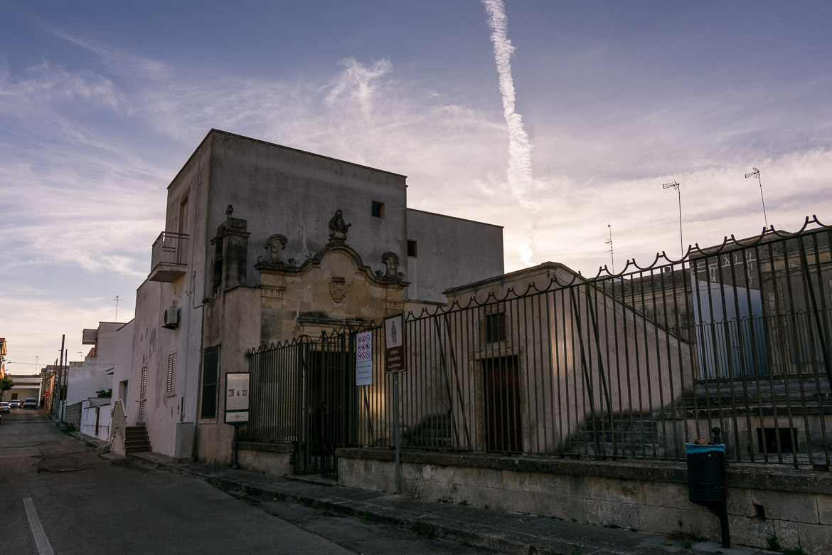 This photo shows the outside of the Crypt of Santa Cristina at sunset.