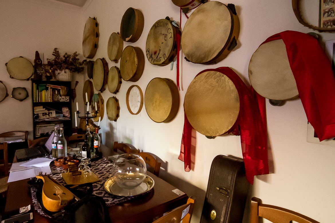 This photo shows a wall filled with tambourines of all sizes and styles. This wall is at the Cultural Centre of Melpignano.