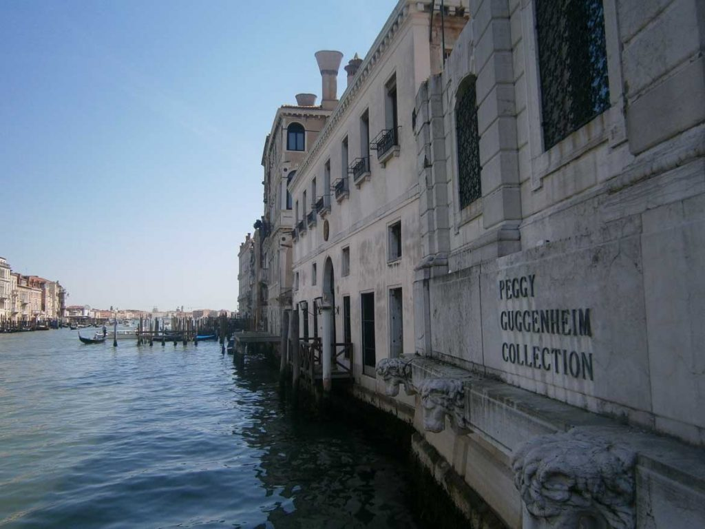 This photo shows the Grand Canal as seen from the Peggy Guggenheim Collection terrace in Venice, Italy. What to do in Venice: our complete guide to La Serenissima.