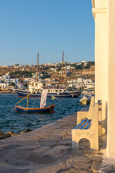 This images shows a couple of traditional boats anchored near Chora in Mykonos.
