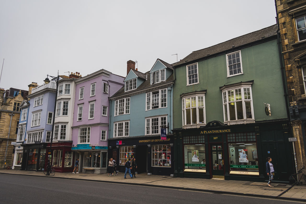 This photo shows a line of colourful houses on High Street, Oxford, UK. We had a wonderful Oxford day trip on our way from Bristol to London during our week-long trip to England.