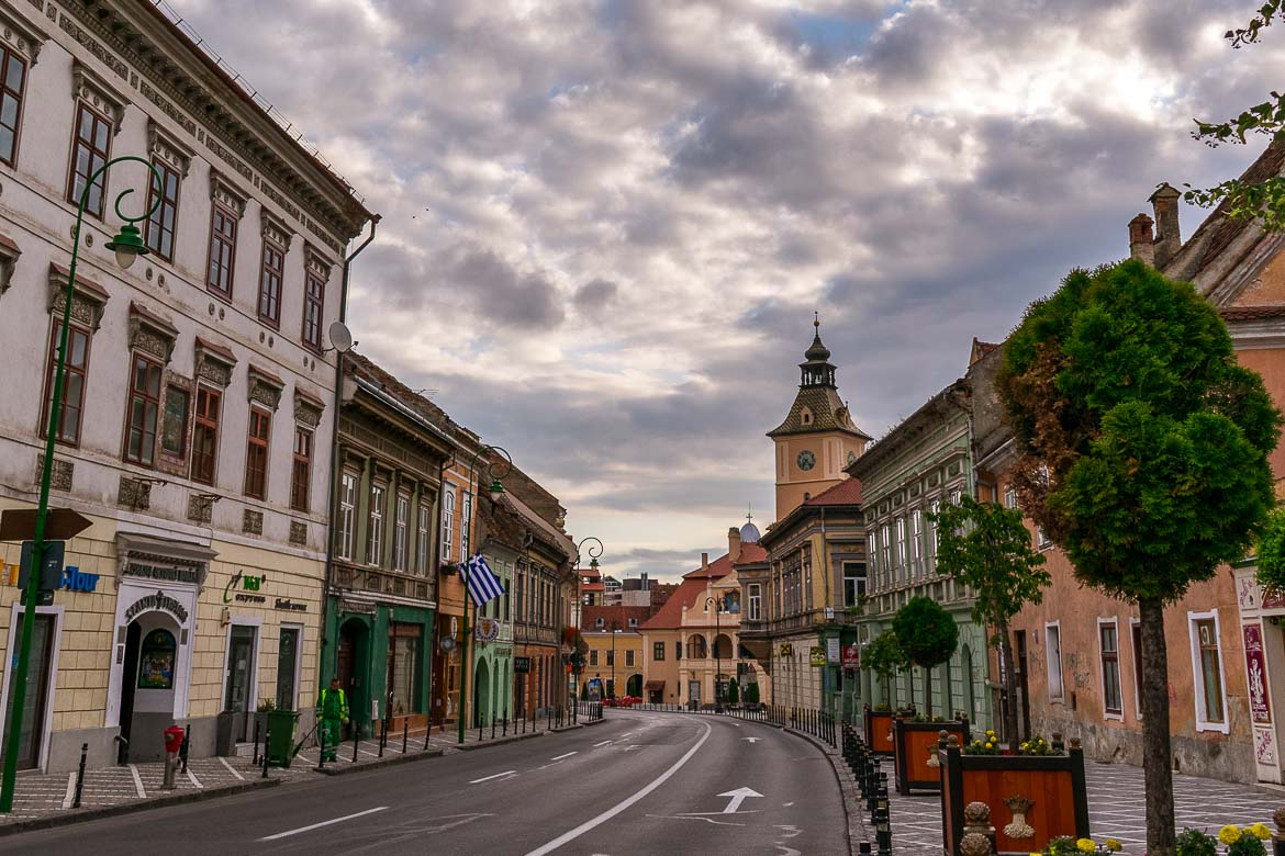 This is a panoramic shot of Brasov Romania very early in the morning on a cloudy summer day.