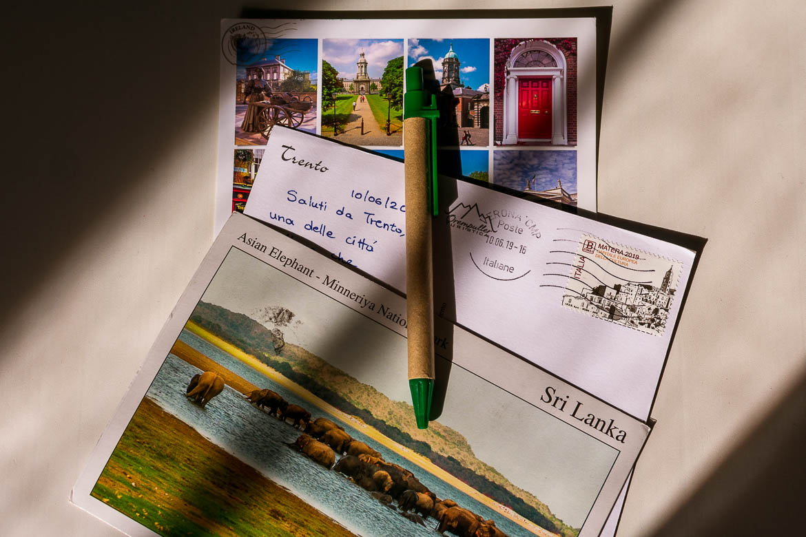 This is a close up of three postcards from our collection and a pen.