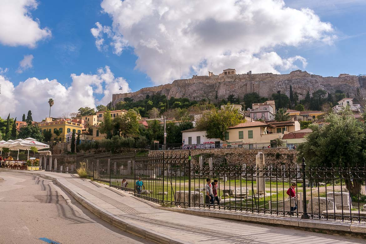 This photo shows the Acropolis of Athens as seen from a quaint street in Plaka.