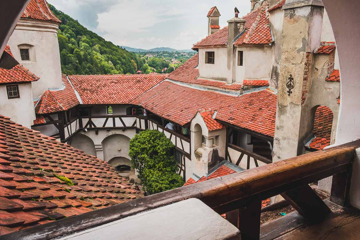This photo shows the view to the interior courtyard from a balcony in Castelul Bran. We loved our trip from Brasov to Bran Castle!