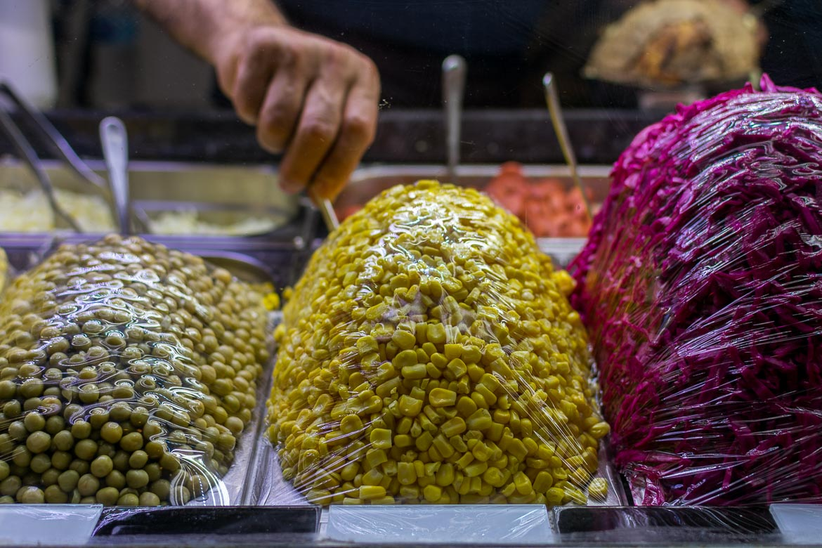 Fresh ingredients at kumpir stalls. Istanbul food guide: Sugar, spice and love.