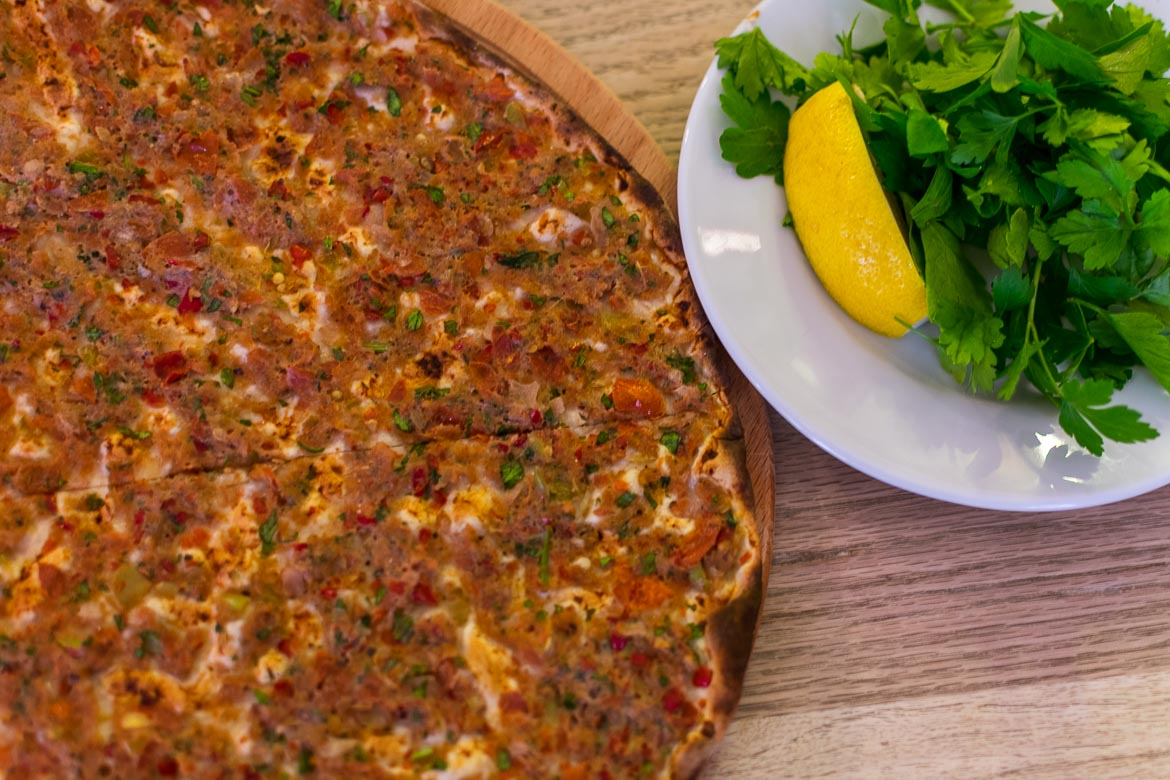 Lahmacun is a traditional and super cheap Turkish food. Istanbul food guide: Sugar, spice and love.