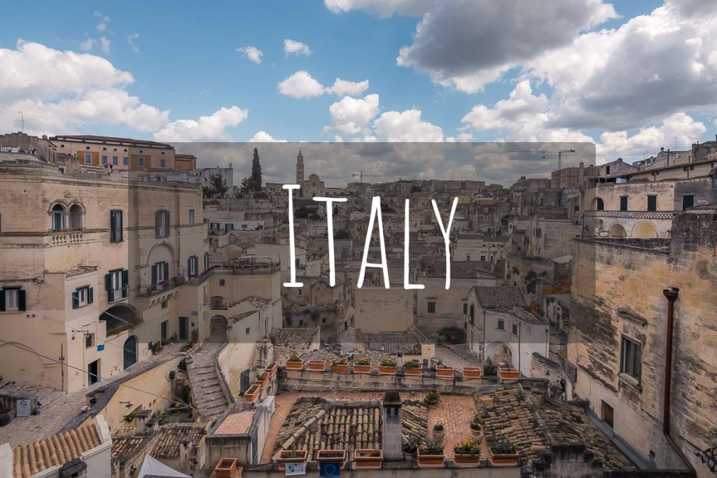 This image shows a panoramic view of Matera in Italy. It's the cover photo of Italy as a destination.