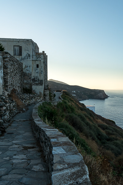 This is a snapshot of the path that encircles Kastro. There are charming old buildings on one side and unique views to the sea on the other.
