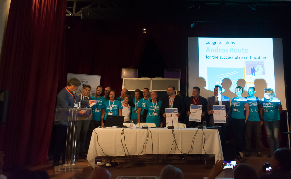 This photo shows the Leading quality trails re-certification ceremony for the 100km long Andros Route which took place during the 1st Andros On Foot walking festival.
