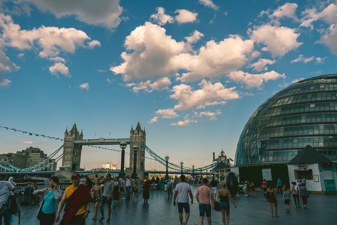 This photo shows the area around the City Hall in London, England with the Tower Bridge in the background. South Bank walk.
