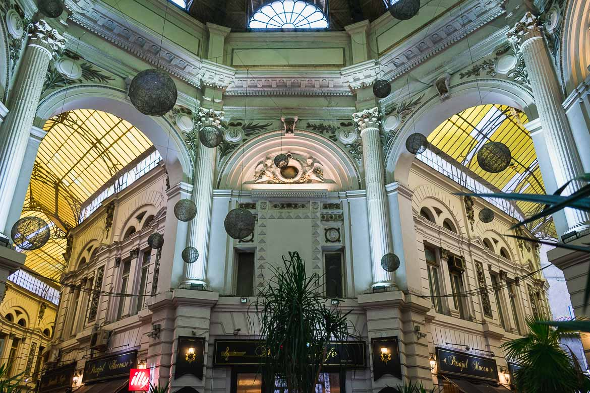 This photo shows the beautiful Pasajul Macca Vilacrosse, a glass covered arcaded street in central Bucharest, Romania. Top things to do in Bucharest.