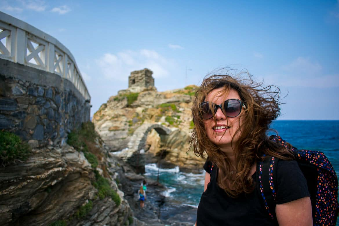 This photo shows Maria smiling happily on a windy day in Chora, Andros, Cyclades, Greece.