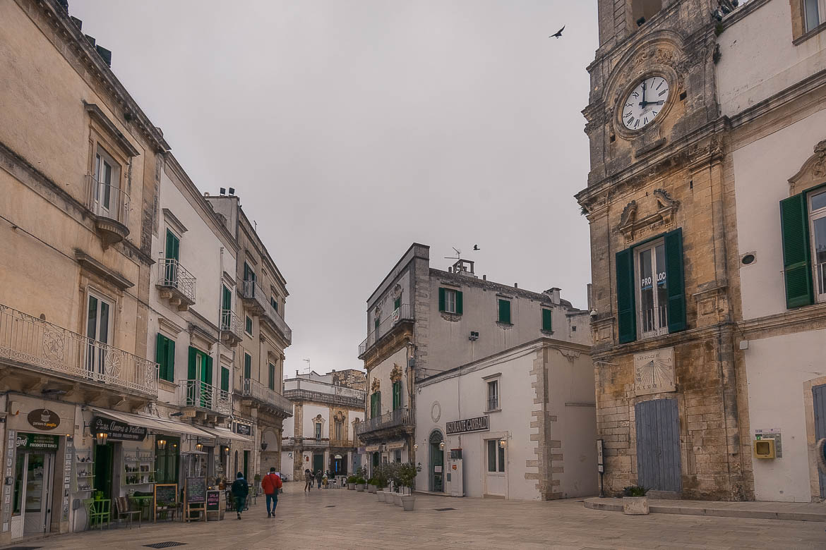 This is an image of Martina Franca Old Town. The architecture is gorgeous and a splendid Clock Tower dominates a shiny small square.