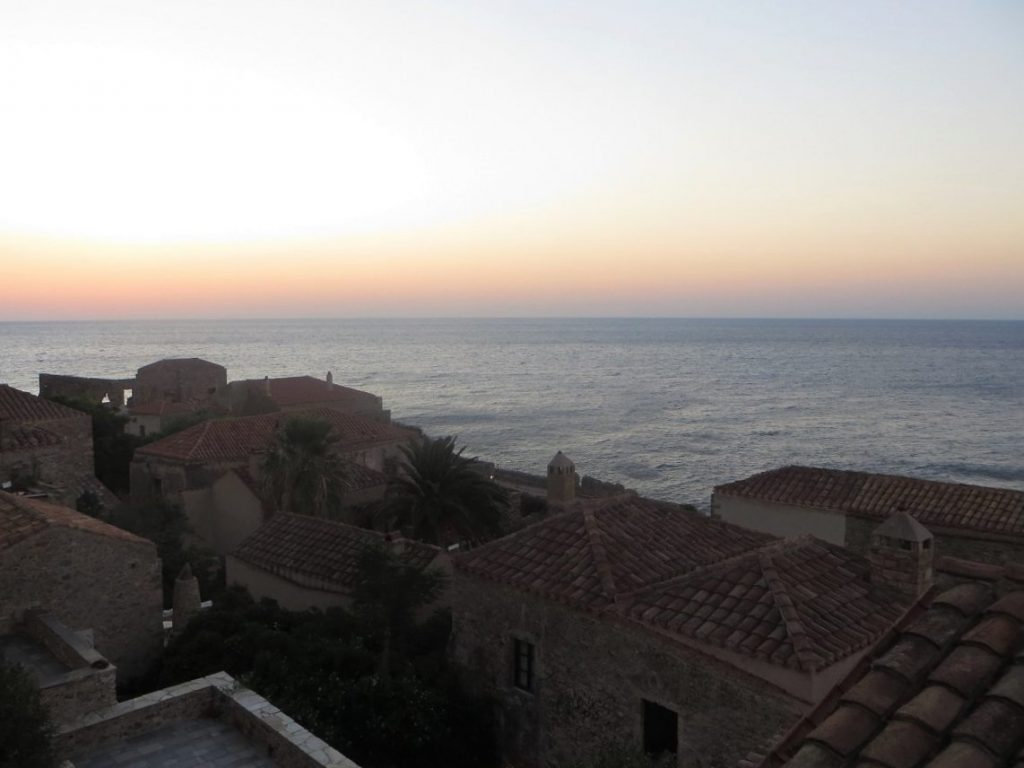 View of Monemvasia Castle at sunrise. Summer in Greece. Monemvasia Castle Travel Guide.