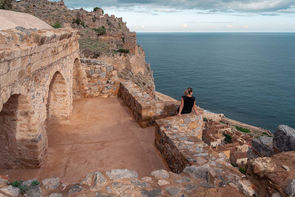 This photo shows Maria gazing at the sea with her back turned to the camera. She is leaning on a wall in the Upper Town.