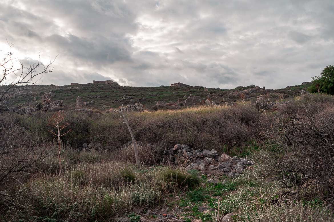 This is the Acropolis of Monemvasia Castle, at the top of the rock under a dramatic, cloudy sky.