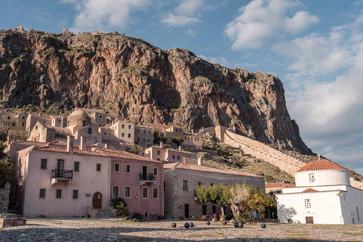 This is a shot of Chrysafitissa Square with the rock looming above. The whitewashed Church of Panagia Chrysafitissa can be seen on the right.
