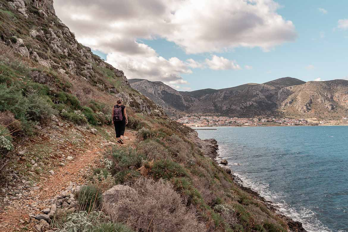 This is a photo of Maria walking along the path that runs around Monemvasia Castle.