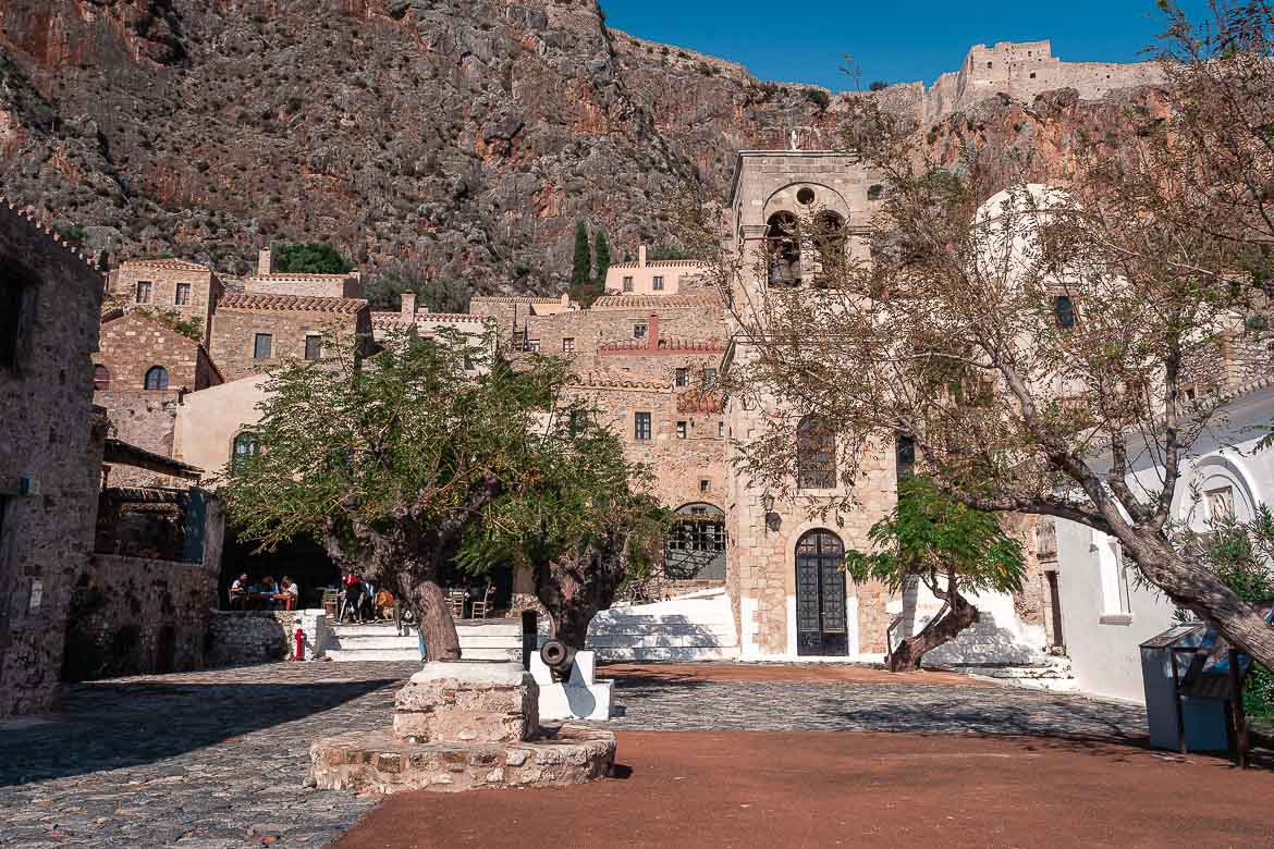 This is a photo of the main square inside Monemvasia Castle. There is a tree and an old cannon dominating the centre of the square but the beautiful bell tower is the real star!