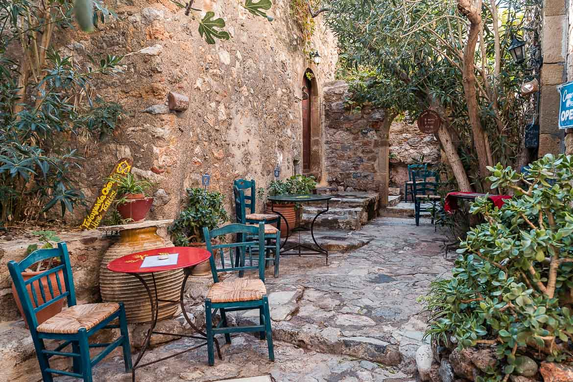 This is a photo of Byron Wine Bar in Monemvasia Castle. The photo was shot in the morning; therefore, the blue tables and chairs are all empty.