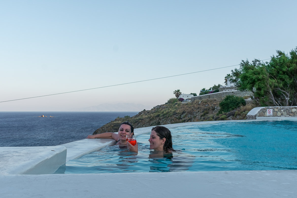 This photo shows Maria and Katerina sipping cocktails in the villa swimming pool. The pool has wonderful sea views.