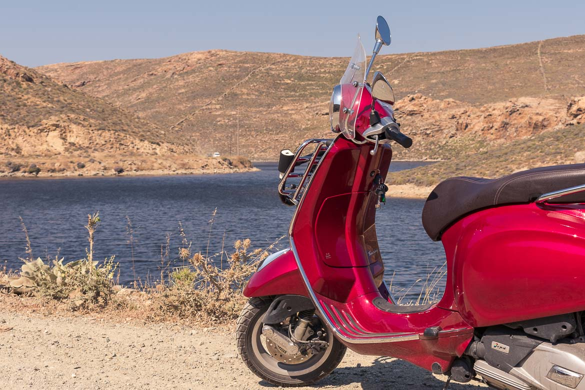 This image shows our red vespa posing in front of Ano Mera Dam.